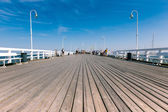 SOPOT, POLAND - 9 AUGUST: People on Sopot molo at Baltic Sea, 9 august 2014. Sopot is major health and tourist resort destination and this pier with 511.5 meters long is the longest wooden pier in Eur — Stock Photo