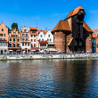 Picturesque scenery in the Old Town of Gdansk in Poland with Motlawa river and The Crane at the far end. — Stockfoto #51286113