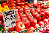 Fresh tomatoes in a market stall in Poland.  — Stock Photo