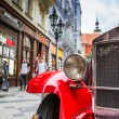 Old red vintage car in downtown of Prague — Stock Photo #51658191
