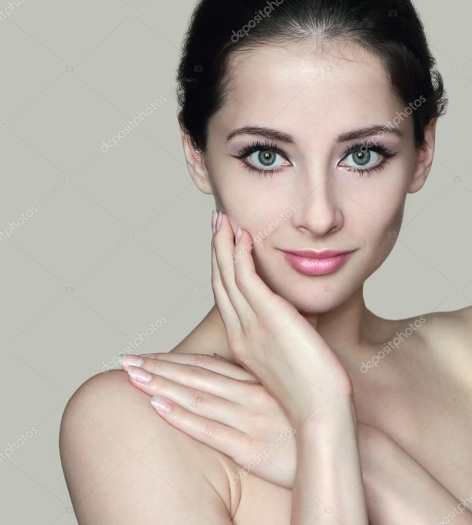 Stock Image of Portrait of a naked woman smiling in