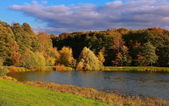 Russian panorama autumn view with blue sky lake and green yellow — Stock Photo