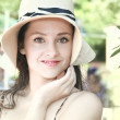 Stock Photo: Beauty womface in hat looking on green nature background. Clo