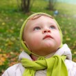 Fun baby looking up with serious thinking face outdoor. Closeup — Stock Photo #13831713