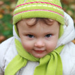 Closeup portrait of baby girl in fun hat looking on autumn backg — Stock Photo