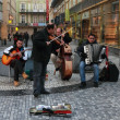 Street orchestra playing music in city center of Prague - Stock Photo