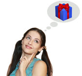 Woman thinking about holiday gift isolated. Bright blue red box — Stock Photo