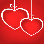 Heart balls on ribbons on red background. Card illustration — Stock Photo