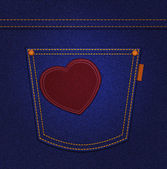 Red heart on jeans pocket on blue denim background — Стоковое фото