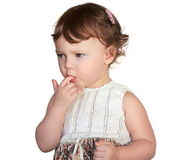 Baby sucking finger with thinking serious look isolated on white — Stock Photo