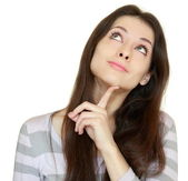 Thinking girl looking up with finger at face with smile isolated — Stock Photo