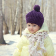 Happy baby girl in hat outdoor winter background — Stock Photo #24009563