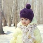 Happy baby girl in hat outdoor winter background — Stock Photo