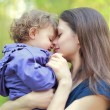 Happy love mother and child girl embracing outdoor summer backgr — Stock Photo