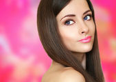 Beauty woman face on pink bright background looking. Closeup por — Stock Photo
