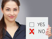 Business woman holding blank and voting for no in option — Stock Photo