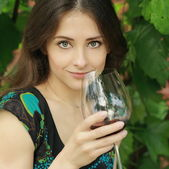 Beauty smiling woman drinking wine outdoor summer background. Cl — Stock Photo
