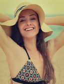 Beautiful laughing woman in hat on sea background. Closeup vinta — Stock Photo