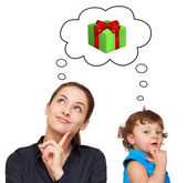 Happy mother and baby girl thinking about present gift in bubble — Stock Photo