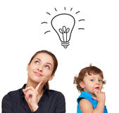 Thinking young woman and cute child with idea bulb above isolate — Stock Photo