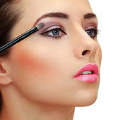 Eyes makeup. Brush applying eye shadows on beauty woman face. Cl — Stock Photo