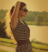 Beautiful long hair girl looking in sun glasses outdoors. Vintag — Stock Photo