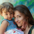 Stock Photo: Beautiful smiling mother and happy fun kid girl looking. Portrai