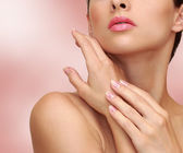 Beauty woman hands with health skin on pink background — Stock Photo