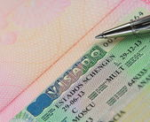Schengen multi visa in passport with pen — Stock Photo
