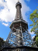 Petrin tower in Prague in Czech Republic on summer blue sky — Stock Photo