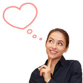 Beautiful woman thinking about love with heart bubble above isol — Stock Photo