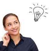 Happy thinking woman looking up with idea bulb above head isolat — Stock Photo