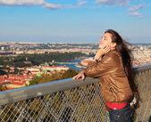 Beautiful woman enjoying in sunny day on Prague city background — Stock Photo