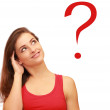 Beautiful thinking teenager girl looking on red question sign — Stock Photo