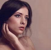 Beautiful woman looking dramatic. Vintage closeup portrait — Stock Photo