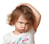 Serious kid thinking about and holding head the hand with fun face — Stock Photo