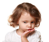 Cute thinking kid girl with hand under face isolated on white — Stock Photo