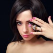 Sexy makeup woman with gemstone ring on the hand looking — Stock Photo