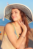 Beautiful relaxing woman with hand near face looking happy — Stok fotoğraf