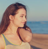 Beautiful woman looking calm on sea background. Closeup — Stock Photo