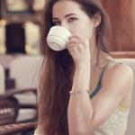 Beautiful thinking girl drinking coffee. Closeup vintage portrait — Stock Photo
