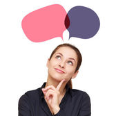 Smiling thinking woman with two web color bubbles above — Stock Photo