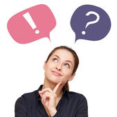 Thinking woman with colorful question mark and exclamation in balloons isolated — Stock Photo