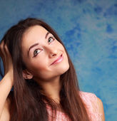 Smiling girl looking up and thinking about. Closeup portrait — Stockfoto