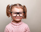 Fun kid girl in glasses looking on empty copy space — Stock Photo
