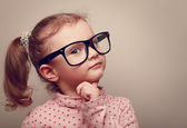 Thinking kid girl in glasses looking happy. Closeup instagram effect portrait — Stock Photo