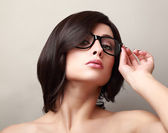 Short black hair woman in fashion glasses looking — Stock Photo