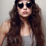Sexy female model in fashion sun glasses. Closeup — Stock Photo #45037565