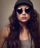 Sexy cool female model in sun glasses. Vintage portrait — Stock Photo