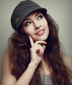 Thinking teen girl in fashion cap looking up. Vintage closeup portrait — Stock Photo